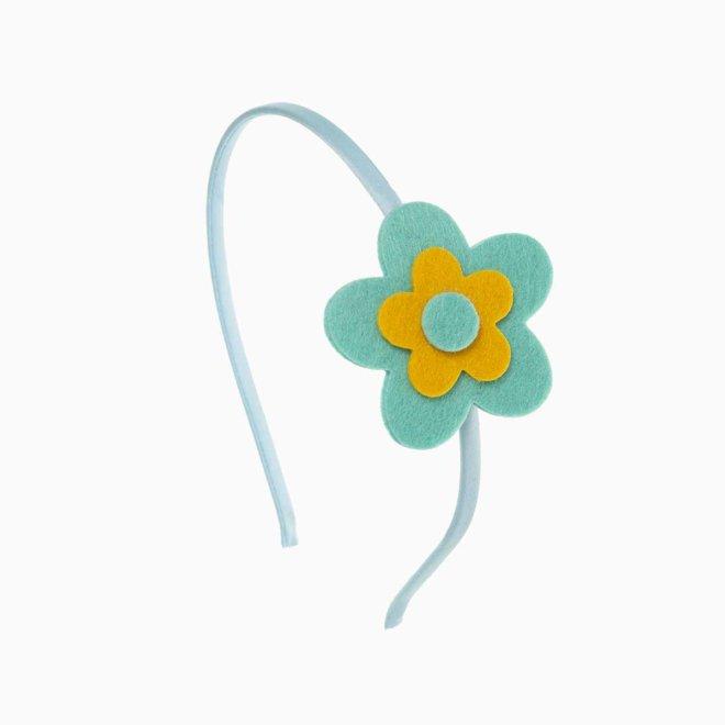 Diadema para niña con flor de fieltro azul